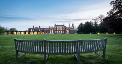Image of Hinxton Hall and lawns at dusk